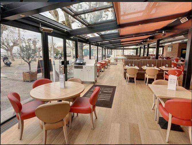 Toiture coulissante pour terrasse de restaurant par verriere ouvrante