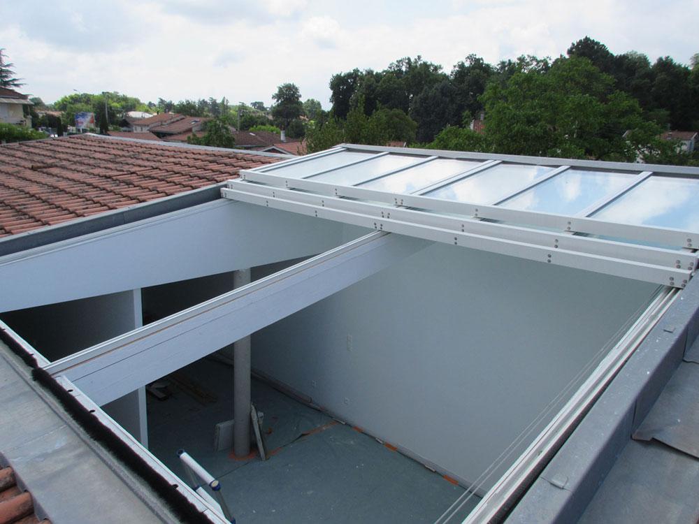 Maison individuelle avec une toiture ouvrante - TOITEL